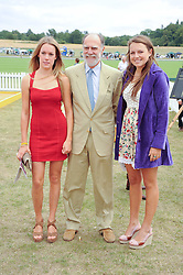 Left to right, the HON.EMILY PEARSON, VISCOUNT COWDRAY and the HON.CATRINA PEARSON at the Veuve Clicquot Gold Cup polo final held at Cowdray Park, Midhurst, West Sussex on 18th July 2010.