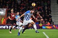 Steve Cook (3) of AFC Bournemouth clears from Huddersfield Town midfielder Laurent Depoitre (20) during the Premier League match between Bournemouth and Huddersfield Town at the Vitality Stadium, Bournemouth, England on 4 December 2018.