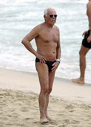 Fashion designer Giorgio Armani spends some winter vacations on the beach in Saint Barthelemy, French West Indies, on December 29, 2008. Armani gets caught in the rain. Photos by ABACAPRESS.COM  | 174045_008 Saint Barthemely