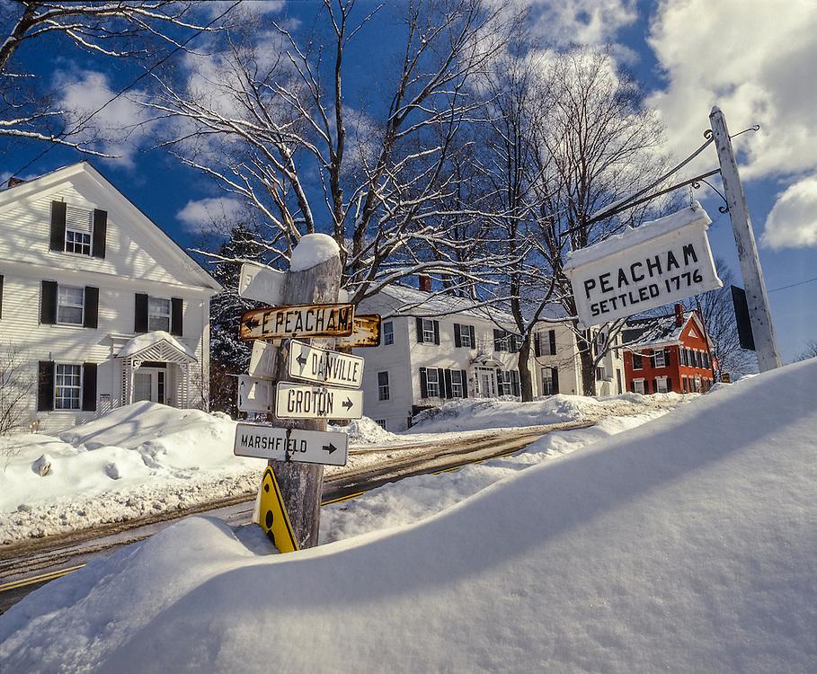 Snowbanks & signs on Main Street, winter village scene, Peacham, VT