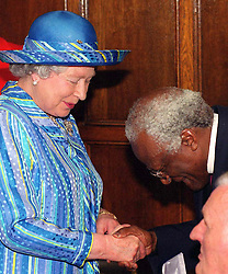 Britain's Queen Elizabeth II is thanked by Archbishop Desmond Tutu after he was presented with the Wilberforce Medal in the Guildhall in Hull. Archbishop Tutu is to give the Wilberforce Lecture in Hull in the evening.    * The Queen was attending several events in the City to Mark the 700th Anniversary of their Royal Charter.