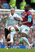 Photo: Ed Godden/Sportsbeat Images.<br /> West Ham United v Bolton Wanderers. The Barclays Premiership. 05/05/2007. Nigel Reo-Coker (R), competes with Bolton's David Thompson.