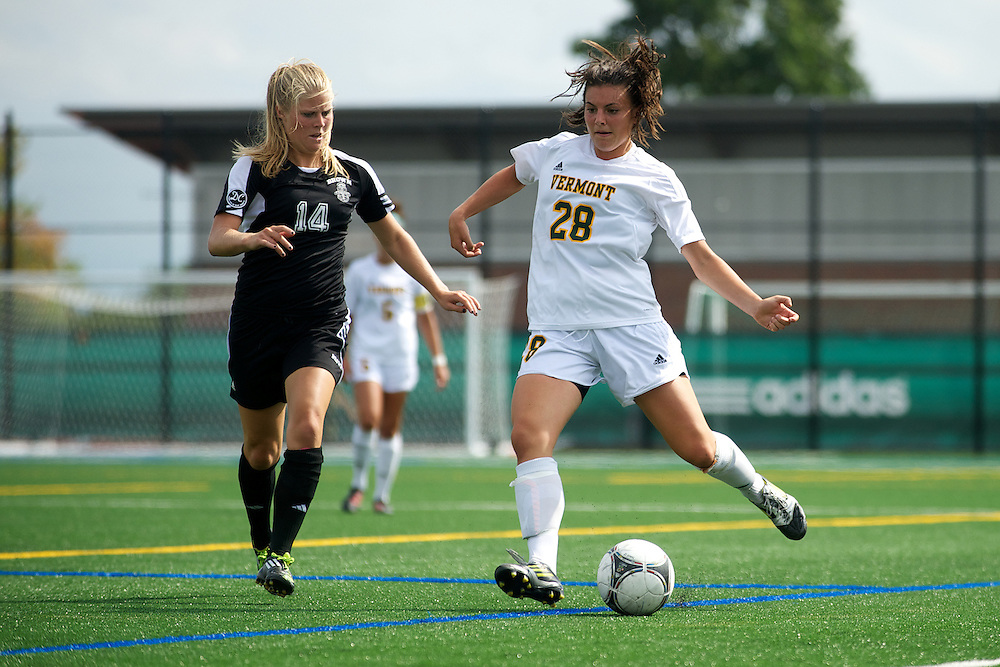 Vermont defenseman Jill Dellipriscoli (28) kicks the ball during the women's soccer game between the Brown Bears and the Vermont Catamounts at Virtue Field on Saturday afternoon September 8, 2012 in Burlington, Vermont.