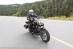 Jonathan Pite riding his Harley-Davidson as he follows the old bikes during the Motorcycle Cannonball Race of the Century. Stage-10 ride from Pueblo, CO to Durango, CO. USA. Tuesday September 20, 2016. Photography ©2016 Michael Lichter.