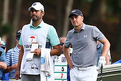 June 21, 2018 - Cromwell, Connecticut, United States - CROMWELL, CT-JUNE 21: Jordan Spieth (R) waits on the 18th tee with his caddie Michael Greller during the first round of the Travelers Championship on June 21, 2018 at TPC River Highlands in Cromwell, Connecticut. (Credit Image: © Debby Wong via ZUMA Wire)
