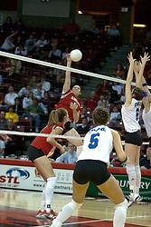 20 November 2004....Laura Doornbos hammers a kill towards the Bulldogs front line.....Illinois State University Redbirds V Drake Bulldogs Women's Volleyball.  Redbird Arena, Illinois State University, Normal IL