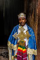 Priest holding the original 12th century gold St. George's cross (weighs 7 kilos), Beta Giyorgis (St. George's church), one of 11 rock hewn churches, Lalibela, Ethiopia.