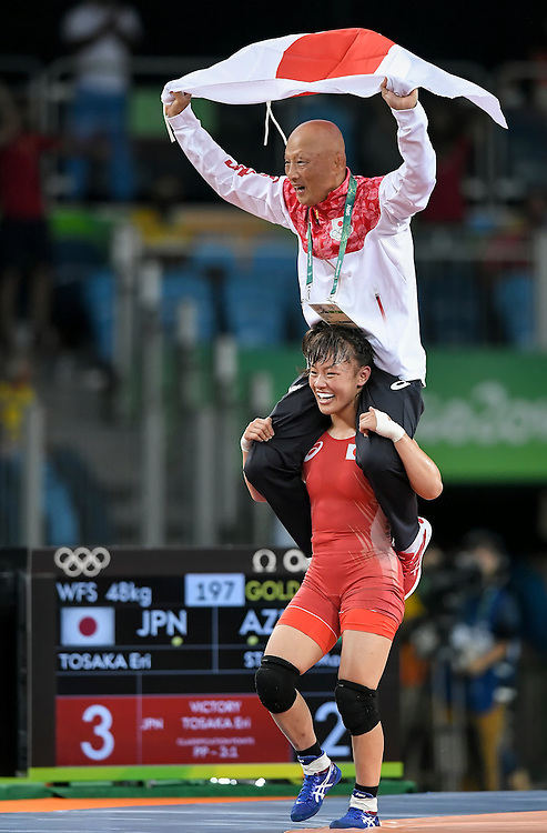 Japan's Eri Tosaka, bottom, carried her coach Kazuhito Sakae on her shoulders after Tosaka won the gold medal in the women's freestyle 48kg wrestling final on Thursday during the 2016 Summer Olympics Games in Rio de Janeiro, Brazil.