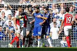 Petr Cech of Arsenal tries to keep apart Gabriel Paulista and Diego Costa of Chelsea as they argue - Mandatory byline: Rogan Thomson/JMP - 07966 386802 - 19/09/2015 - FOOTBALL - Stamford Bridge Stadium - London, England - Chelsea v Arsenal - Barclays Premier League.