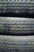 pile of three car tires