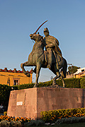 Statue of Miguel de Allende in the Plaza Civica in the historic Spanish Colonial district of San Miguel de Allende, Guanajuato, Mexico.