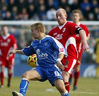 Photo: Chris Ratcliffe.<br />Gillingham v Bristol City. Coca Cola League 1. 26/12/2005.<br />Steven Brooker (R) of Bristol City clips the ball past Danny Jackman.