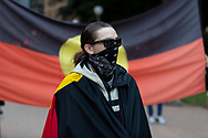 Protester wearing protective face mask prepares to march on Parliament House at the Archibald Fountain in Hyde Park on 02 June, 2020 in Sydney, Australia. Black Lives Matter protest was arranged by Australian Communist Party with Australia's First Nations People following the killing of an unarmed black man George Floyd at the hands of a police officer in Minneapolis, Minnesota. (Photo by Pete Dovgan/ Speed Media)