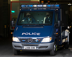 © Licensed to London News Pictures. 13/03/2021. London, UK. An armoured police van departs Westminster Magistrates Court where today Wayne Couzens appeared in custody . He is charged with the murder and kidnapping of Sarah Everard.  Photo credit: George Cracknell Wright/LNP