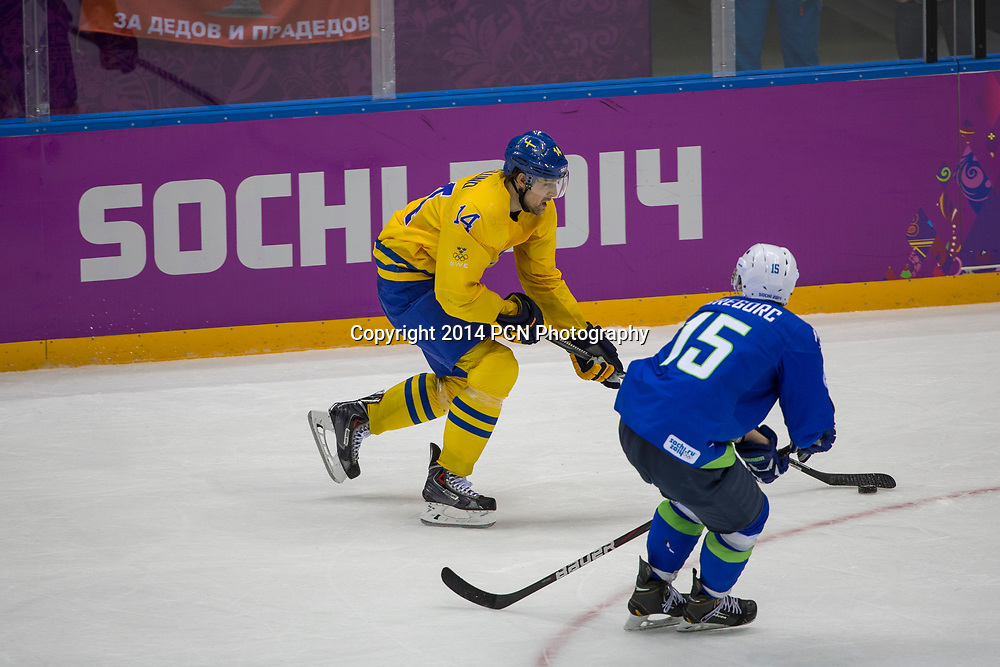 Patrik Berglund (SWE)-14, Blaz Gregorc (SLO)-15 during Sweden vs Slovenia game at the Olympic Winter Games, Sochi 2014