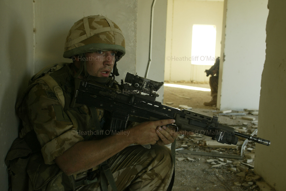 """Soldiers from the Black Watch Battlegroup including Royal Marines from 40 Commando on patrol in search of any Iraqi insurgent activity. The soldiers and marines were deployed via Warrior armoured vehicles from the nearby foward operating base """"Springfield"""",which lies close to the east bank of the Euphrates river 25 miles south of Baghdad.The Battlegroup were controversially deployed  to monitor movements to and from the embattled city of Falluja....."""
