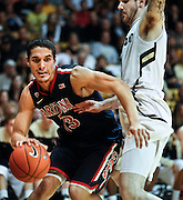 SHOT 1/21/12 5:56:45 PM -  Arizona's Nick Johnson #13 tries to drive past Colorado's Nate Tomlinson #1 during their PAC 12 regular season men's basketball game at the Coors Events Center in Boulder, Co. Colorado won the game 64-63..(Photo by Marc Piscotty / © 2012)