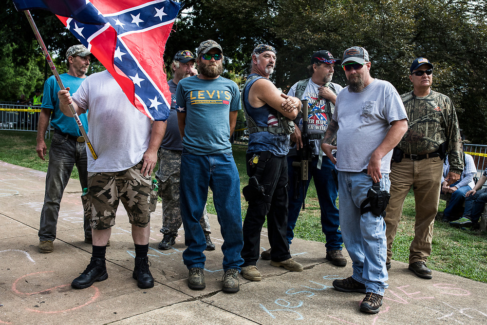 CHARLOTTESVILLE, VA. USA. August 12th 2017. White nationalists with a confederate flag and strongly armed wait for the rally to start.<br /> <br /> <br /> The rally occurred amidst the backdrop of controversy generated by the removal of Confederate monuments throughout the country in response to the Charleston church shooting in 2015. The event turned violent after protesters clashed with counter-protesters, which combined with the subsequent vehicle-ramming attack left over 30 injured