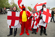 London, UK. Wednesday 23rd April 2014. Men dressed up as Saint George and one dragon on St George's Day. With chainmail, St Georges Cross shields and flags, this type of dressing up has become popular as a sign of patriotism and fun as groups go out drinking on the 23rd April each year.