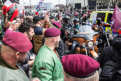 London, UK. 12th April 2019. Thousands of bikers ride over Westminster bridge as part of a Rolling Thunder Ride for Soldier F organised by Harry Wragg and other armed forces veterans in support of the 77-year-old former soldier known as Soldier F who is to be prosecuted for the murders of James Wray and William McKinney at a civil rights march in Londonderry on Bloody Sunday in 1972.