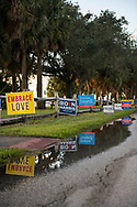 Campaign signs outside Eastminster Presbyterian Church, a voting precinct in Indialantic, Florida, on November 3, 2020.