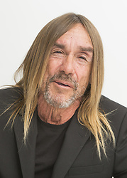 December 5, 2016 - Hollywood, California, U.S. - IGGY POP co-writer for the title song 'Gold' for the up coming movie with the same title. James Newell Osterberg, Jr., known professionally as Iggy Pop (born April 21, 1947), is an American singer-songwriter, musician and actor. He was the vocalist of influential proto-punk band The Stooges, who reunited in 2003, and is well known for his outrageous and unpredictable stage antics. Pop's music has encompassed a number of styles over the course of his career, including garage rock, punk rock, hard rock, art rock, new wave, jazz and blues. Though his popularity has fluctuated through the years, many of Pop's songs have become well-known, including 'Lust for Life', 'The Passenger', 'Real Wild Child (Wild One)', 'Candy' (a duet with Kate Pierson of The B-52's), 'China Girl', 'Nightclubbing', 'Search and Destroy' and 'I Wanna Be Your Dog.' In 2010, The Stooges were inducted into the Rock and Roll Hall of Fame. (Credit Image: © Armando Gallo via ZUMA Studio)