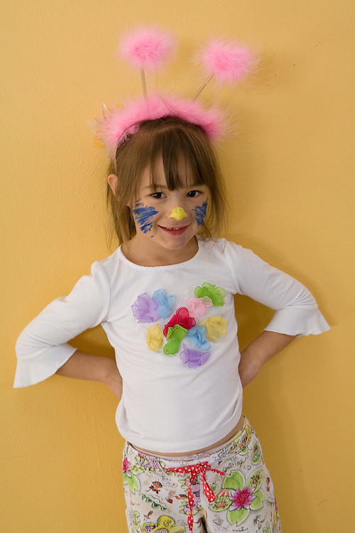 United States, Washington, Bellevue, girl (age 6) with face paint and antenna headband.  MR