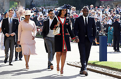 Idris Elba and Sabrina Dhowre followed by Oprah Winfrey (fourth right) arrive at St George's Chapel at Windsor Castle for the wedding of Meghan Markle and Prince Harry.