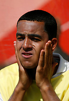 Photo: Glyn Thomas.<br />England v Paraguay. Group B, FIFA World Cup 2006. 10/06/2006.<br /> England's Theo Walcott puts on his suncream on the bench.