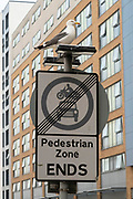 Seagull on top of a pedestrian zone ends sign on 14th June 2021 in Birmingham, United Kingdom. In this area in the city centre, seagulls come in numbers to scavenge food dropped near the open market and food stalls.