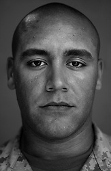 Cpl. Mathew Gonzalez, 21, Hollywood, Florida, Weapons Platoon, Kilo Co., 3rd Battalion 1st Marines, 1st Marine Division, United States Marine Corps, at the company's firm base in Haditha, Iraq on Sunday Oct. 22, 2005.