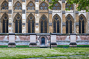 Building hoarding erected around part of Westminster Abbey on the the 25th of May 2021 in Westminster, Central London. The Hoarding is disguised to look like part of the abbey including images of pillars and doors to dilute the impact of the building work.