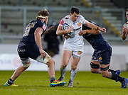 Exeter Chiefs fly-half Joe Simmonds is held by Sale Sharks Sale Sharks lock Lood De Jager during a Gallagher Premiership Round 11 Rugby Union match, Friday, Feb 26, 2021, in Eccles, United Kingdom. (Steve Flynn/Image of Sport)
