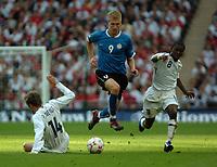 Photo: Tony Oudot.<br /> England v Estonia. UEFA European Championships Qualifying. 13/10/2007.<br /> Ragnar Klavan of Estonia goes away from Shaun Wright Phillips and Phil Neville of England