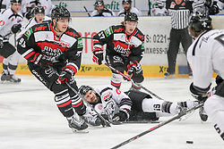 19.12.2014, Lanxess Arena, Koeln, GER, DEL, Koelner Haie vs Nuernberg Ice Tigers, 28. Runde, im Bild Sebastian Uvira (Koelner Haie),Marcel Ohmann (Koelner Haie) und am Boden Jason Jaspers (Nuernberg Ice Tigers), Koelner Haie - Nuernberg Ice Tigers am 19.12.2014 in der Lanxess-Arena in Koeln (Nordrhein-Westfalen), Foto: Eibner // during Germans DEL Icehockey League 28th round match between Koelner Haie vs Nuernberg Ice Tigers at the Lanxess Arena in Koeln, Germany on 2014/12/19. EXPA Pictures © 2014, PhotoCredit: EXPA/ Eibner-Pressefoto/ Kohring<br /> <br /> *****ATTENTION - OUT of GER*****