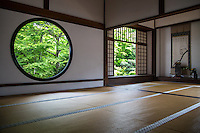 """Genko-an is famous for its two large windows.  """"The Window of Enlightenment"""" is round, showing the harmony of the universe.  The squared window is called """"The Window of Confusion"""" symbolising humans' lives of suffering.  Both windows overlook the same garden, though the effect of looking through each window is quite different.  The garden's plants and stones are arranged to create an elegant world of wabi and sabi.  Genko-an Temple was originally built as a hermitage for the head priest of Daitoku-ji Temple, but was later turned into a Zen temple."""