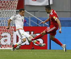 June 24, 2017 - Kazan, Russia - Alexander Samedov (R) of Russia national team shoots to score a goal as Andres Guardado of Mexico national team defends during the Group A - FIFA Confederations Cup Russia 2017 match between Russia and Mexico at Kazan Arena on June 24, 2017 in Kazan, Russia. (Credit Image: © Mike Kireev/NurPhoto via ZUMA Press)