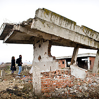 """Komoran Village, Kosovo 19 February 2011<br /> Ruins of a house damaged during the Kosovo war 98-99.<br /> After the Kosovo War and the 1999 NATO bombing of Yugoslavia, the territory of Kosovo came under the interim administration of the United Nations Mission in Kosovo (UNMIK), and most of those roles were assumed by the European Union Rule of Law Mission in Kosovo (EULEX) in December 2008.<br /> In February 2008 individual members of the Assembly of Kosovo declared Kosovo's independence as the Republic of Kosovo. Its independence is recognised by 75 UN member states. On 8 October 2008, upon request of Serbia, the UN General Assembly adopted a resolution asking the International Court of Justice for an advisory opinion on the issue of Kosovo's declaration of independence. On 22 July 2010, the ICJ ruled that Kosovo's declaration of independence did not violate international law, which its president said contains no """"prohibitions on declarations of independence"""".<br /> Photo: Ezequiel Scagnetti"""