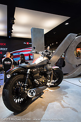 """Moto Guzi's """"V-9 Bobber"""" on display in their booth at EICMA, the largest international motorcycle exhibition in the world. Milan, Italy. November 21, 2015.  Photography ©2015 Michael Lichter."""