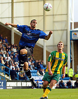 Photograph:Scott Heavey.<br />Gillingham v West Bromwich Albion. Nationwide Duvision one. 04/10/2003.<br />Chris Hope leaps to clear from Rob Hulse