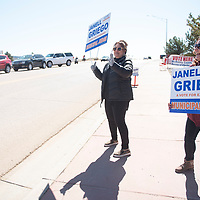 Dawn Garcia, center, and Michelle Skersick, right, campaign for their sister Janell Griego in front of the Southside Fire Station No. 1 polling location Tuesday, March 3, in Gallup.