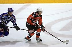 Michael Rafl (12) and Robar Mitja (51) at ice hockey match Acroni Jesencie vs EC Pasut VSV in EBEL League,  on November 23, 2008 in Arena Podmezaklja, Jesenice, Slovenia. (Photo by Vid Ponikvar / Sportida)