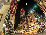 The Empire State Building lit up in Red color in Manhattan, New York City.