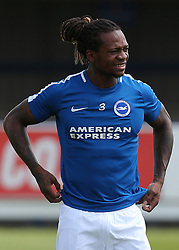 """Brighton and Hove Albion'ss Gaetan Bong warms up before kick off during a pre season friendly match at The Cherry Red Records Stadium, Kingston Upon Thames. PRESS ASSOCIATION Photo. Picture date: Saturday July 21, 2018. Photo credit should read: Mark Kerton/PA Wire. EDITORIAL USE ONLY No use with unauthorised audio, video, data, fixture lists, club/league logos or """"live"""" services. Online in-match use limited to 75 images, no video emulation. No use in betting, games or single club/league/player publications."""