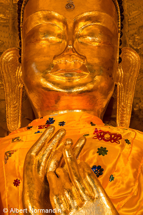 Golden Buddha statue face with hands and fingers, Pathein