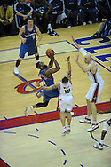 The Washington Wizards defeated the Cleveland Cavaliers 88-87 in Game 5 of the First Round of the NBA Playoffs, April 30, 2008 at Quicken Loans Arena in Cleveland.<br /> DeShawn Stevenson of Washington shoots over Zydrunas Ilgauskas and Delonte West.