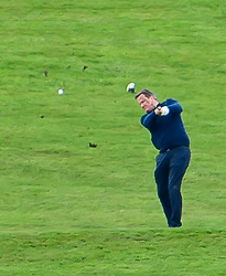 © Licensed to London News Pictures. 23/04/2016. Chandler's Cross, UK. British prime minister DAVID CAMERON pulls up a big divot from the ground while hiding the ball as he plays golf with President of The United States of America, BARAK OBAMA at The Grove golf Course in Chandler's Cross, Hertfordshire. Photo credit: Ben Cawthra/LNP