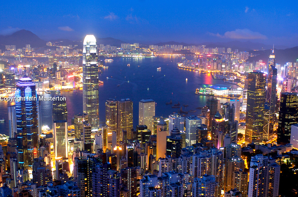 Evening view of skyline of Hong Kong and Vicoria Harbour