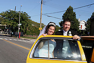 Brooklyn, N.Y.  The wedding ceremony of Christine Neve and Vincent Brace at Saints Simon and Judes R.C. Church on Ave T. Posing with a NYC taxi.