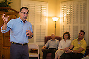 "03 AUGUST 2012 - GILBERT, AZ:  MATT SALMON talks to Republican voters during a campaign ""meet & greet"" in Gilbert, AZ, Friday night. Salmon is running in the Republican primary for Arizona's 5th Congressional District. Salmon previously served in Congress from 1994 until 2000. CD5 is a primarily Republican district, with a large number of conservative Mormons, in the suburbs east of Phoenix. Salmon is running against Kirk Adams, a former Speaker of the Arizona House of Representatives. Whoever wins the August 28 Republican primary will probably win in November's general election.  PHOTO BY JACK KURTZ"